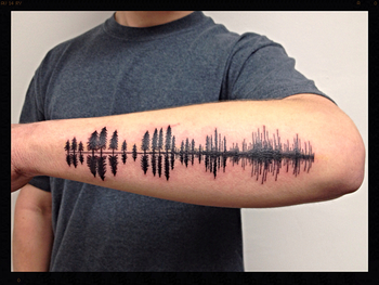 Black Pine tree silhouettes turning into soundwave tattoo
