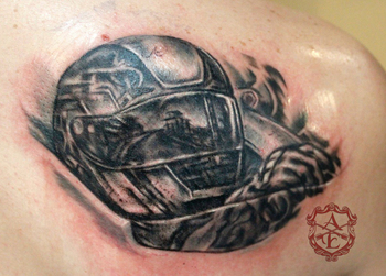 Race Car Helmet Tattoo done by Sean Ambrose at Arrows and Embers Custom Tattooing