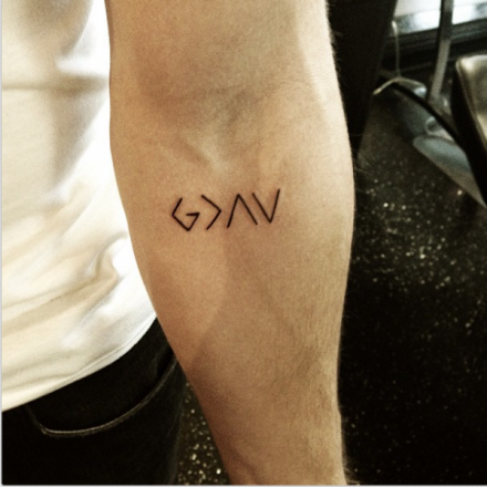 Nick jonas tattoo god is greater than the highs and lows original