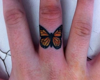 butterfly finger tattoo ~ I would TOTALLY get this on the middle finger I never wear a ring on.