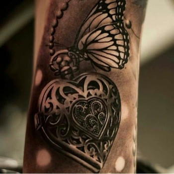 Heart locket with butterfly tattoo