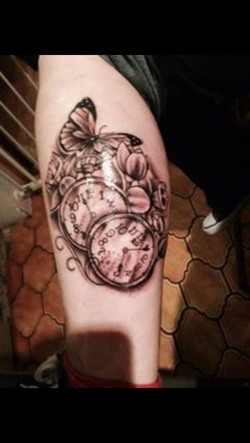 Tattoo pocket watches and butterflies. The watches have the times my daughters were born and the one