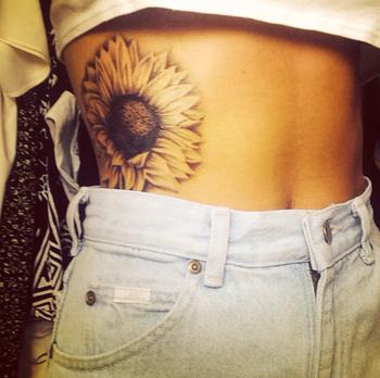 Sunflower tattoo #ribtattoo #realism
