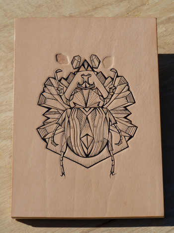 tattooed onto leather, tooled and embossed. Bug series fixed onto wooden panel 12 x 17 cm Little Leat
