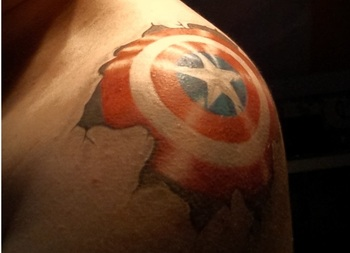 Cap's shield done by Carlos Guzman at Body Language Tattoo in Astoria, Queens