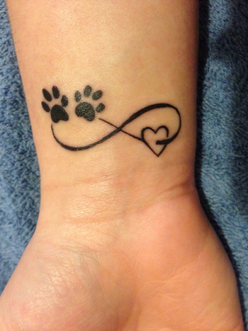 One pinner stated: Love my new tattoo! Infinity paw print heart for my love of animals!