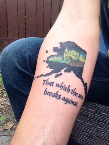 Alaska tattoo. The word Alaska is taken