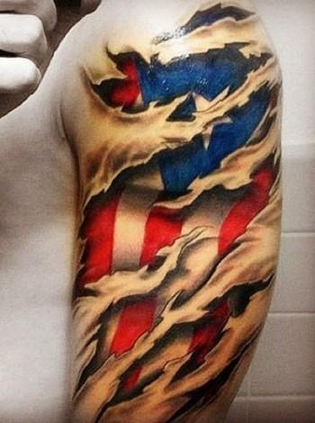 American flag under skin rip tattoo on shoulder