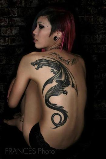 http://www.inkedgirlsmag.com/static/images/girls/portfolios/665799_dragon_web_size.jpg
