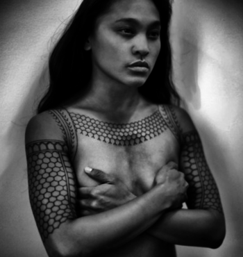 Philippines | Young, and strikingly beautiful, tattooed Kalinga woman.