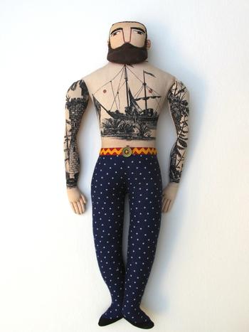 a tattooed man | Doll