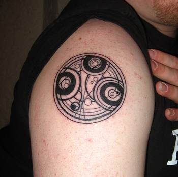 Doctor Who Gallifreyan tattoo - if i ever get one, it will be completely blue and it will have to say