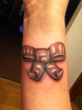 Love it! #film #bow #tattoo