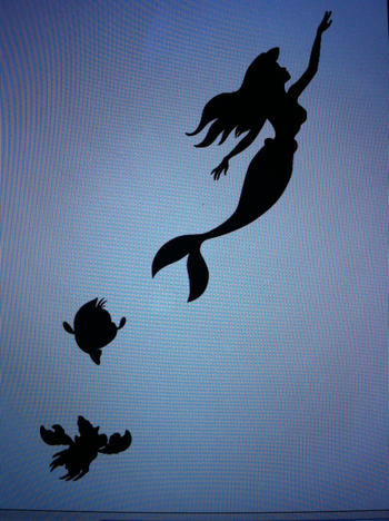 The Little Mermaid silhouette as a tattoo behind my ear!! Tribute to classic Disney haha someone has