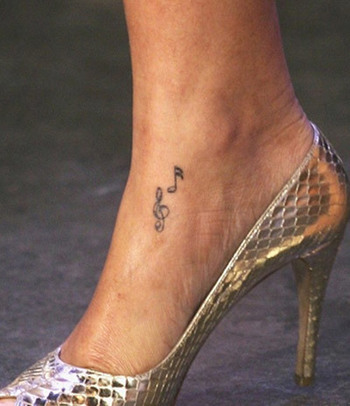 10 Rihanna Tattoos And Their Meanings