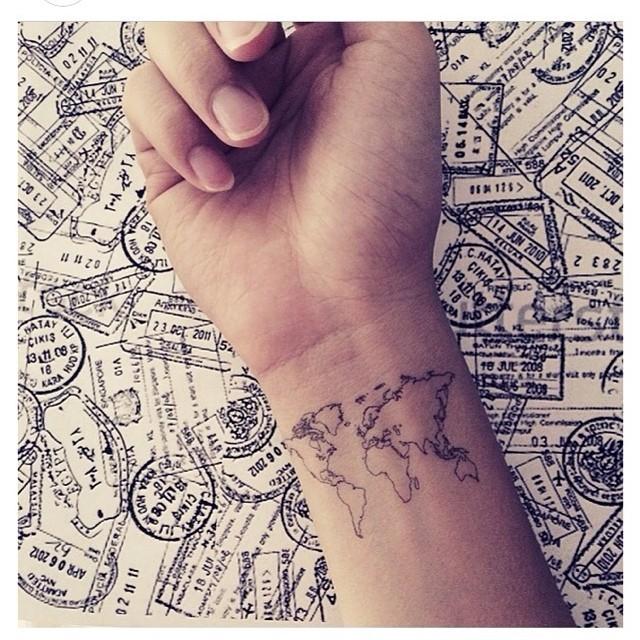 17 tiny travel tattoos for your next big adventure c0f6140b 031c 4787 bd19 e04bf78bafd2 original