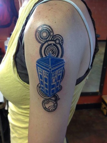 I love the simple color scheme, but the intricate tattoo.
