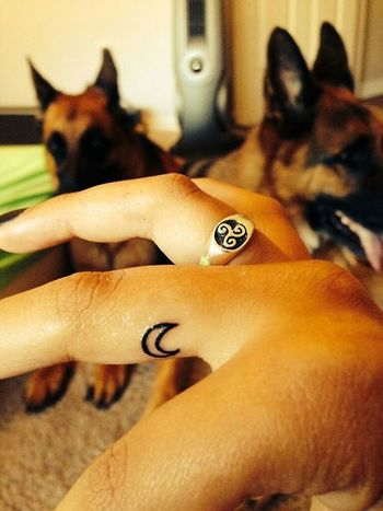 A little crescent moon tattoo on the