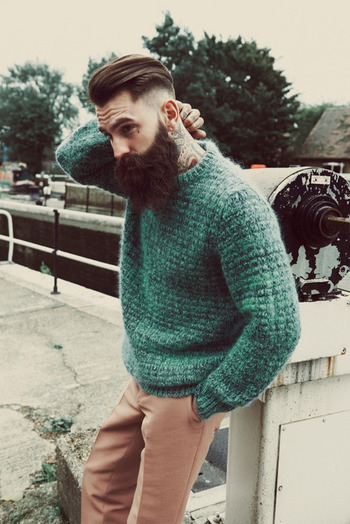 How many tattooed, bearded bad boys can pull off a green sweater? Ricki fuckin Hall, that's how many