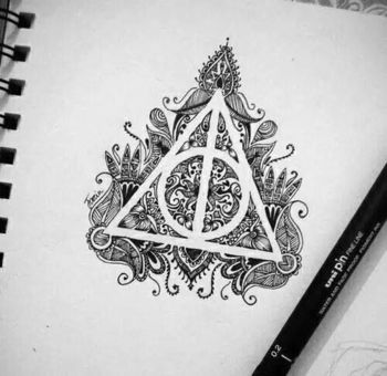 Deathly hallows doodle. Would be cool to do with the antipossession symbol as well.