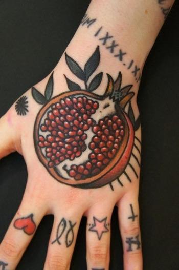 pomegranate hand tattoo by Dane Mancini- i