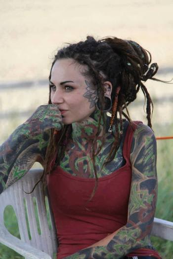 tats, dreads and i love the lotus on the side of her face!