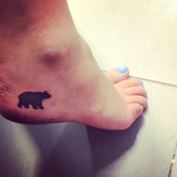 My new tattoo! West coast Canada themed, picked up studying in Italy. Black bear silhouette foot tatt