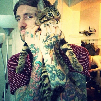 Is it just us, or is there a lot of pictures of hot guys with ink… and… their cat?