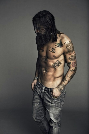 full thick black beard and long hair beards bearded man men mens' style denim jeans tattoos tattooed
