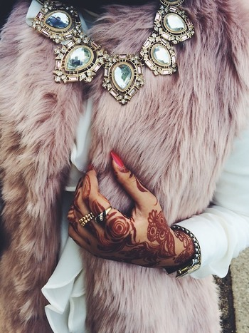 Loud and Proud: bobble necklace, henna details, violet fur vest All serious fashion play.
