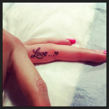 Or maybe this, with our anniversary. I like the finger tattoo idea.