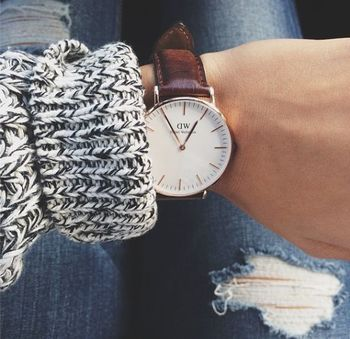 adding sleek oversized round watch to high contrast chunky sweater and ripped jeans. totally paradoxi