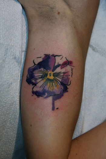 Pansy symbol of remembrance. Also like the idea of the pansy incomplete/bleeding to further the conce