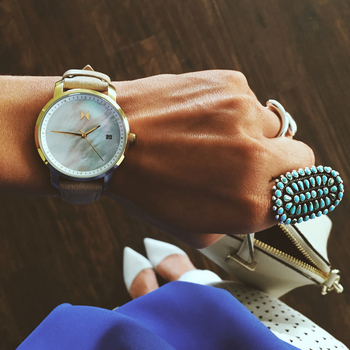 Women's formal attire accented with a Gold Pearl Leather Watch.