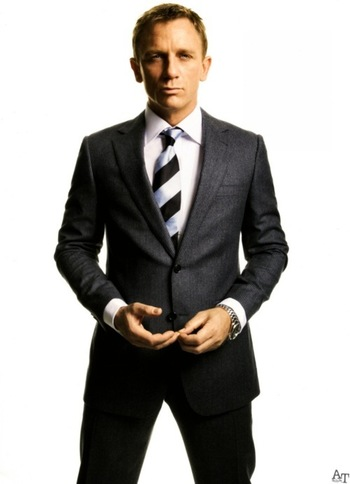 sharp, charcoal grey, European cut suit; also love the striped tie