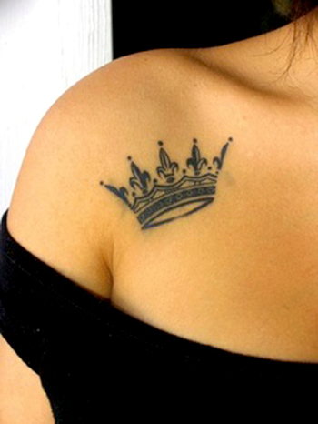Simple beauty of a crown tattoo on a girls  shoulder