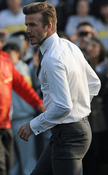 i'm not sure why david beckham took off his suit jacket here...but let's all take a moment of silence