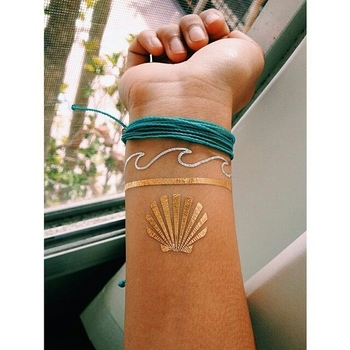 Don't believe this is an actual tattoo but i love the waves around the wrist.