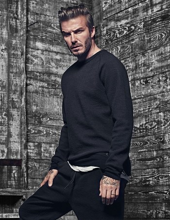 A smouldering David Beckham shows off his biceps
