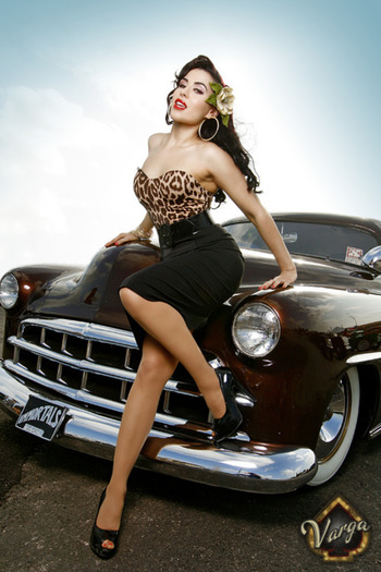 Car [ with sassy saucy woman perched on it ]
