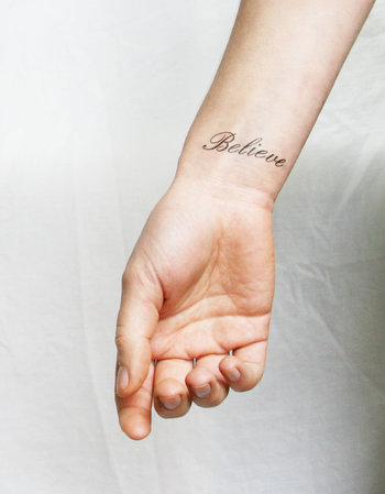 'Believe' inspiring words temporary tattoo by Pepper Ink, a lovely tattoo in a beautiful script to re