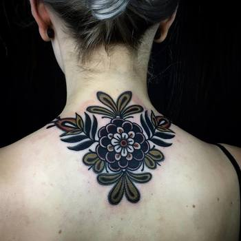 25 Impeccable Traditional Flower Tattoos | Tattoodo.com