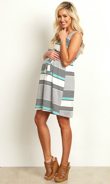 We love this maternity dress that has all out favorite details. A v-neckline and sash tie detail with