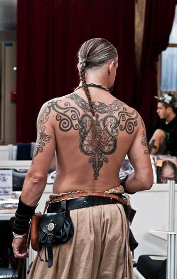 not very Viking to swan about with your shirt off, but still, awesome tattoo. Viking tattoo