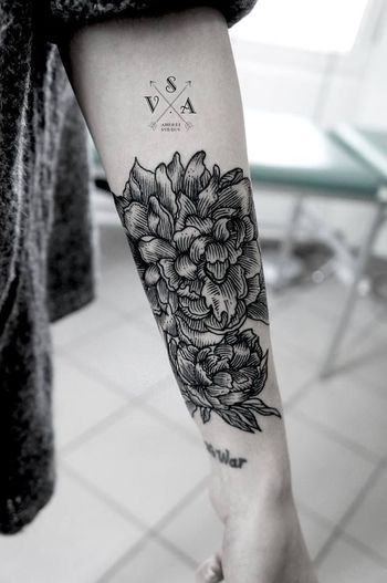 Flower forearm tattoo for women