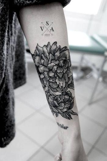 Flower forearm tattoo for women