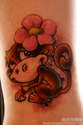 funny monkey tattoo wearing a flower....I want something similar for my Monkey Jean! :)