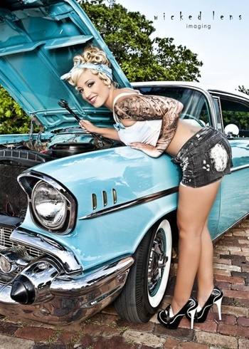 Girls with tattoos working on old cars..yes please.