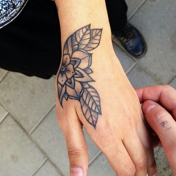 Traditional Flower hand tattoo I would need color but love the way it follows the curves of her hand