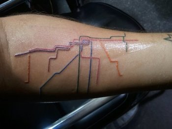 For the love of CTA: Map tattoos adorn arms, feet